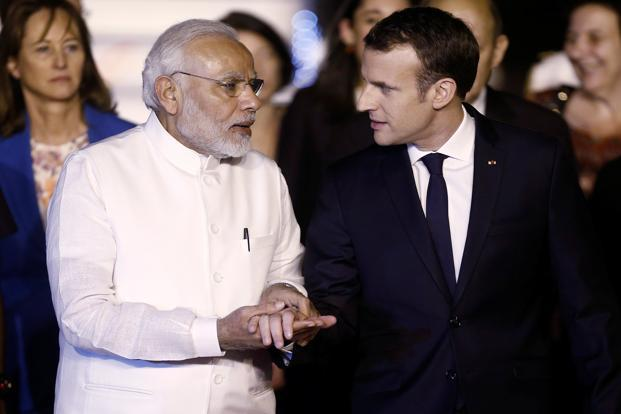 French President Emmanuel Macron with Prime Minister Narendra Modi upon his arrival at Air Force Station, Palam, in New Delhi on Friday. Photo: Reuters