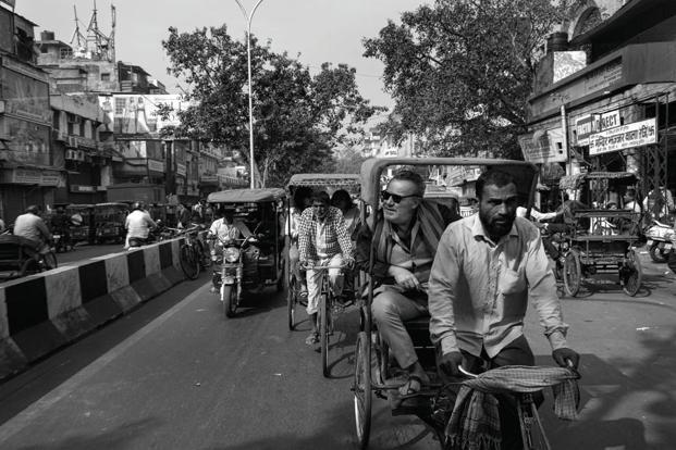 The chef on a cycle rickshaw, often considered the best way to negotiate the narrow streets of Chandni Chowk. Photo: Rohit Chawla
