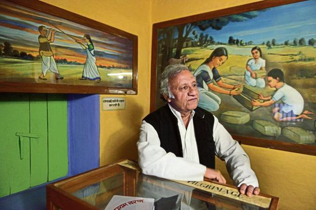 Banasthali Vidyapith vice-president Siddharth Shastri—behind him are paintings of Shantabai making the first Banasthali mud brick and learning self-defence.
