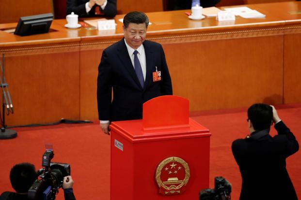 Chinese President Xi Jinping looks on after dropping his ballot during a vote on a constitutional amendment lifting presidential term limits, at the third plenary session of the National People's Congress in Beijing on 11 March, 2018. Photo: Reuters