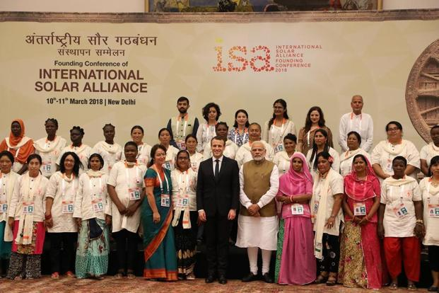 "Prime Minister Narendra Modi (front R) and French President Emmanuel Macron (front L) meet with the ""solar mamas""—a group of rural solar engineer—after the start of the founding conference of the International Solar Alliance (ISA) in New Delhi on Sunday. Photo: AFP"