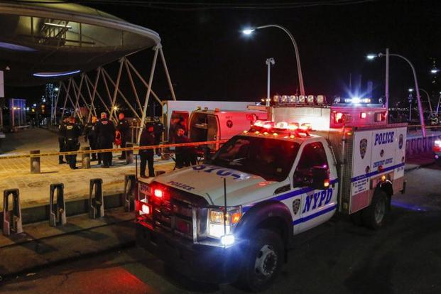Tour helicopter crashes into East River