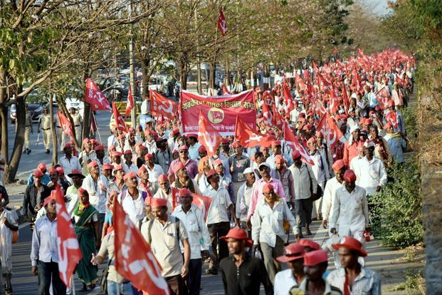 Farmers march from Nashik to Mumbai to surround Vidhan Bhawan on Monday demanding a loan waiver in Mumbai. Photo: PTI
