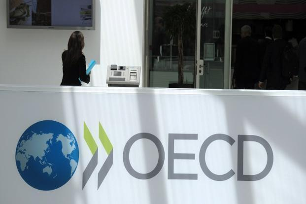 Potential trade war threatens global economic growth, OECD warns