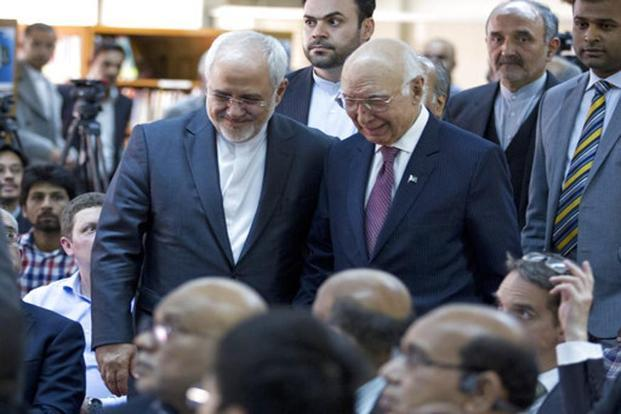 Visiting Iranian foreign minister Mohammad Javad Zarif, left, arrives with former Pakistani adviser on foreign affairs Sartaj Aziz, to attend a seminar at the Institute of Strategic Studies in Islamabad on Monday. Photo: AP