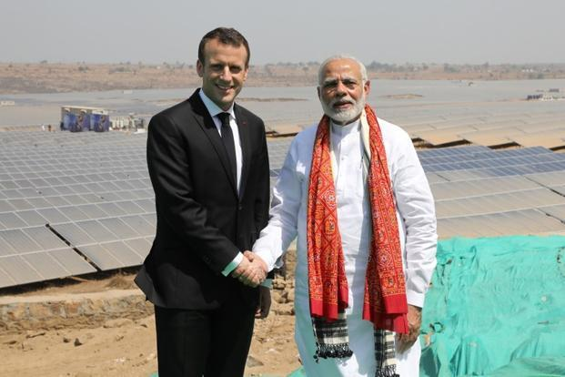Prime Minister Narendra Modi and French President Emmanuel Macron pose during the inauguration of a solar power plant in Mirzapur in Uttar Pradesh on 12 March, 2018. Photo: Reuters