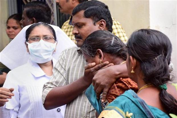 Relatives of the trekkers injured in Korangani reserve forest fire wail outside Theni Government Medical College hospital, in Theni on Monday. Photo: PTI
