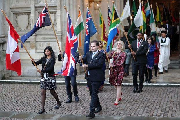 Flags of the Commonwealth countries are paraded during a Commonwealth Day Service at Westminster Abbey in London on 12 March. Photo: AFP