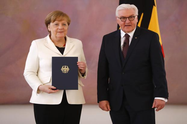 German chancellor Angela Merkel receives her certificate of appointment from President Frank-Walter Steinmeier after being re-elected as chancellor, during a ceremony at Bellevue Palace in Berlin, Germany, March 14, 2018.  Photo: Reuters