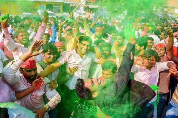 Samajwadi Party supporters celebrate their success in Phulpur and Gorakhpur Lok Sabha by-poll election in Allahabad on Wednesday. Photo: PTI