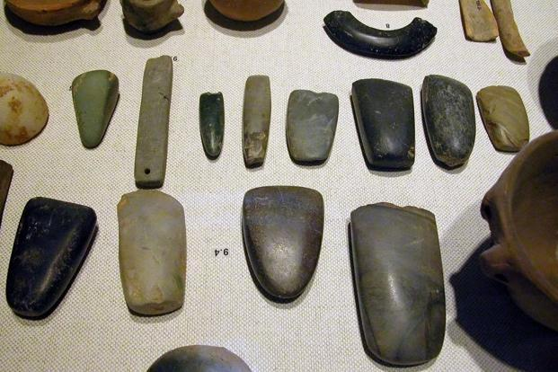 A file photo of an array of Neolithic artifacts, including bracelets, axe heads, chisels, and polishing tools. Photo: Wikimedia Commons