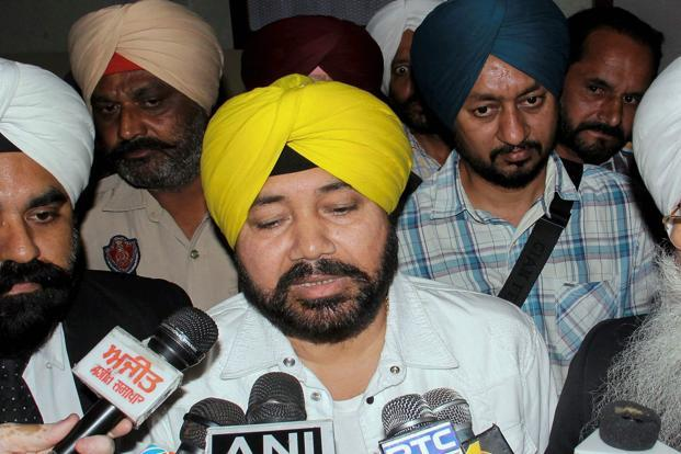 Pop singer Daler Mehndi speaks to the media after he was granted bail, at district court complex in Patiala on Friday. He was convicted in a 2003 human trafficking case. Photo: PTI