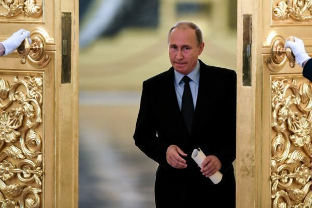 Putin wins fourth term, opponents say vote rigged