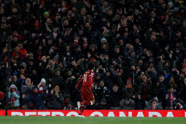 Salah celebrates his fourth goal against Watford on Saturday. Photo: Reuters