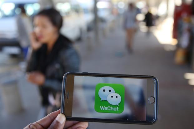 Tencent's business revolves around its vast social networks WeChat and QQ, through which it distributes games, videos and music. Photo: Reuters