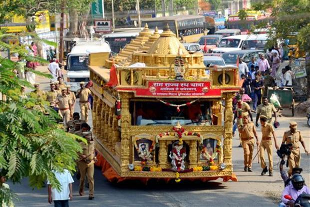 Ram rajya rath yatra reaches rameswaram to rousing reception livemint police personnel look on as they walk along side the chariot modelled on the proposed ram thecheapjerseys Gallery