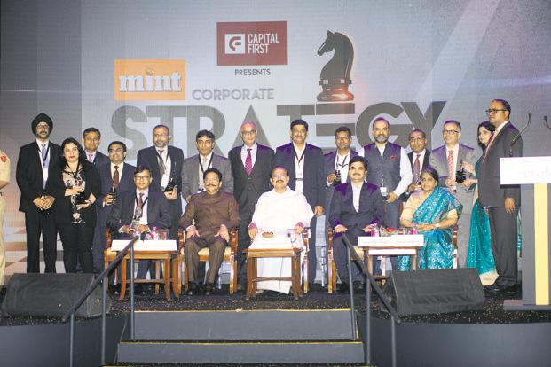 Vice president of India Venkaiah Naidu (centre, right) and Maharashtra governor C. Vidyasagar Rao (centre, left) with the winners of the Mint Corporate Strategy Awards 2018 in Mumbai. Photo by Abhijit Bhatlekar/ Mint
