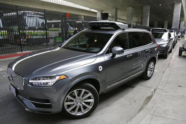In this 2016 file photo, Uber's autonomous car heads out for a test drive in San Francisco. In a letter to Uber CEO, Arizona governor Doug Ducey said he expected companies developing self-driving technology to make safety their top priority. Photo: AP