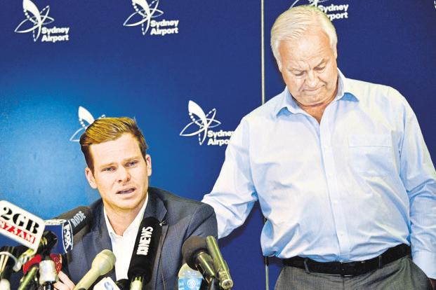 Former Australia cricket captain Steve Smith being comforted by his father Peter after he broke down in tears during a press conference at  Sydney Airport on Thursday. Photo: AFP