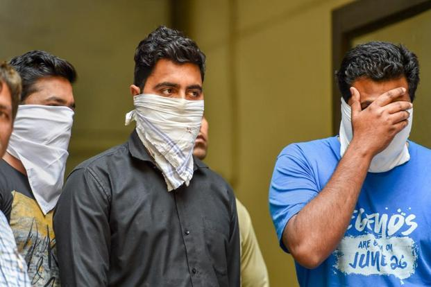 Police show a coaching centre owner and two teachers who were arrested on suspicion of their involvement in circulating the leaked CBSE question papers on social media groups, in New Delhi on Sunday. Photo: PTI