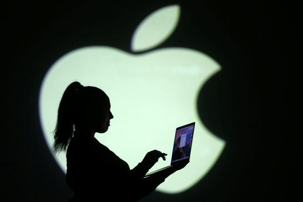 Apple remains on track to become the first company to reach the market capitalization of $1 trillion. Photo: Reuters