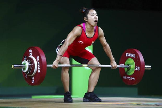 Mirabai Chanu lifted more than double her body weight (103kg, 107kg and 110kg) in three successful attempts to claim the clean and jerk as well as the overall Games record.  Photo: AP