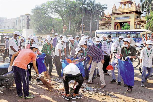People take part in a Swachh Bharat Mission programme at Banaras Hindu University on the occasion of Gandhi Jayanti. The number of Indians who defecate in the open has dropped from some 550 million in 2014 to 200 million by early 2018. Photo:  PTI