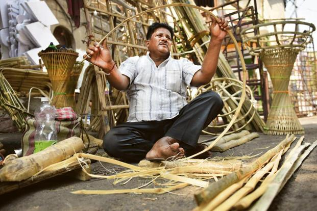 A clutch of bamboo artisans sit near the 125-year-old Minerva Theatre on Beadon Street.