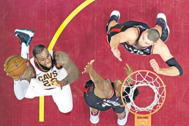Cleveland Cavaliers forward LeBron James shoots in a game against Toronto Raptors in Cleveland on Tuesday. Photo: Tony Dejak/AP
