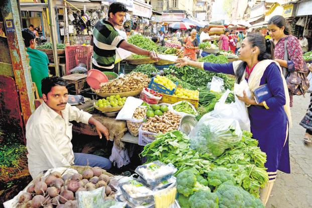 A file photo of a vegetable market in Mumbai. In the unorganized sector too, shoppers and shopkeepers are adapting. Photo: Abhijit Bhatlekar/Mint