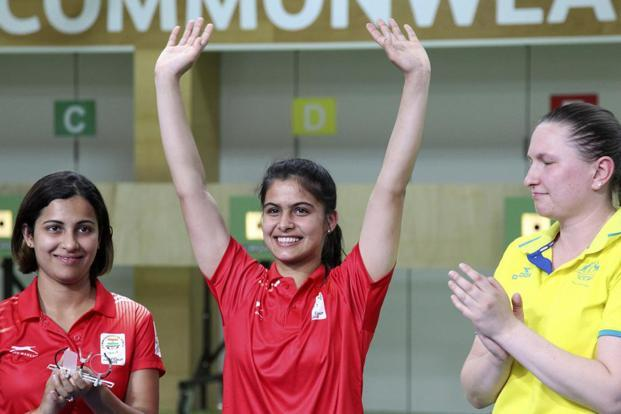 Manu Bhaker (c) reacts after winning the gold medal. Photo: PTI