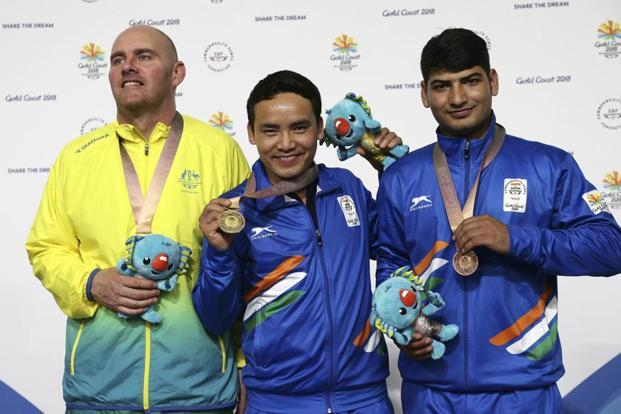Kerry Bell of Australia (L) silver medal, Jitu Rai of India (C), gold medal, and Om Mitharval of India (R), bronze medal, during the men's 10m Air Pistol final at the Belmont Shooting Centre during the 2018 Commonwealth Games in Brisbane, Australia. Photo: AP