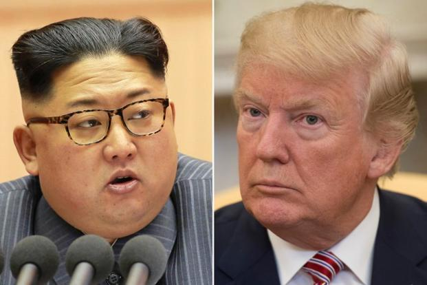 US President Donald Trump (right) has expressed hope that he North Korea's Kim Jong un would reach a deal on 'de-nuking' the Korean peninsula. Photo: AFP