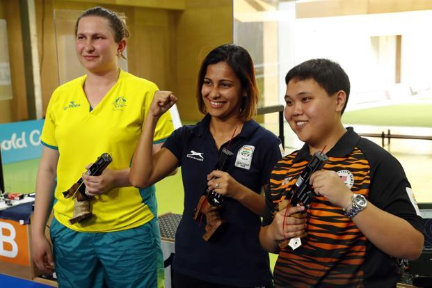 Heena Sidhu, centre, shot a final score of 38, two of them perfect fives, to claim the top honours ahead of Australian Elena Galiabovitch, left. The bronze medal went to Malaysia's Alia Azahari. Photo: Reuters
