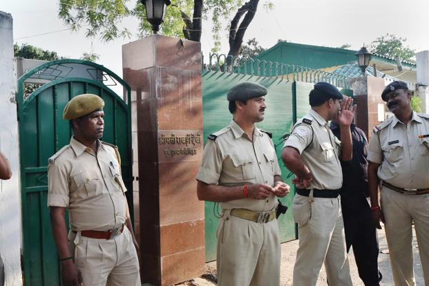 Security personnel stand outside Rabri Devi's residence in Patna on Tuesday. Photo: PTI