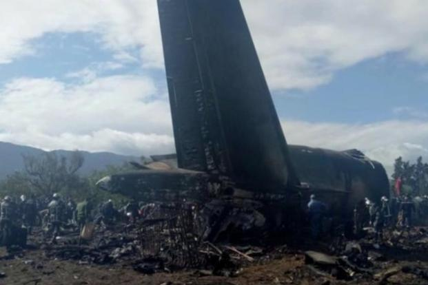 An Algerian military plane is seen after crashing near an airport outside the Algerian capital Algiers on 11 April, 2018 in this still image taken from a video. Photo: Reuters