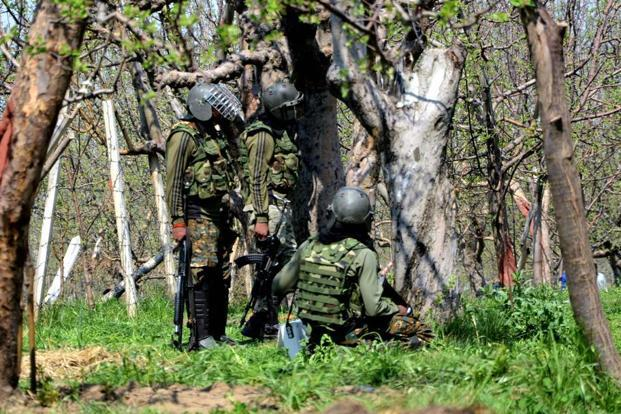 Representational image. Army soldier take position behind trees during a gun battle between security forces and militants in Shopian in South Kashmir. Photo: PTI