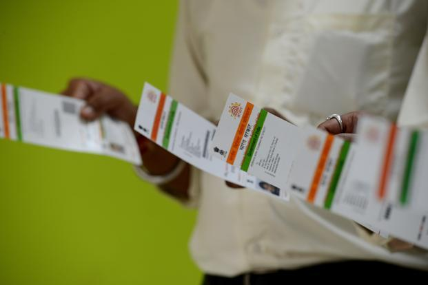 "The government claimed that the authorities have been able to unearth Rs33,000 crore, which was earlier not taxed, through the ""voluntary seeding"" of Aadhaar with PAN cards. Photo: Hemant Mishra/Mint"