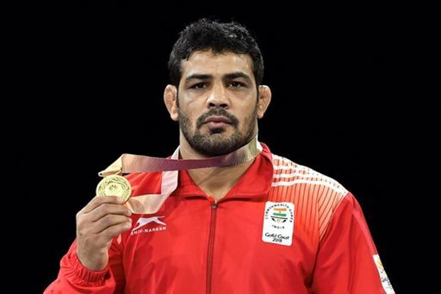 Defending champion Sushil Kumar barely spent any time on the mat his final lasting just a minute and 20 seconds and claimed easy victories to claim his third successive gold at the Games a love affair that began in 2010 Delhi edition