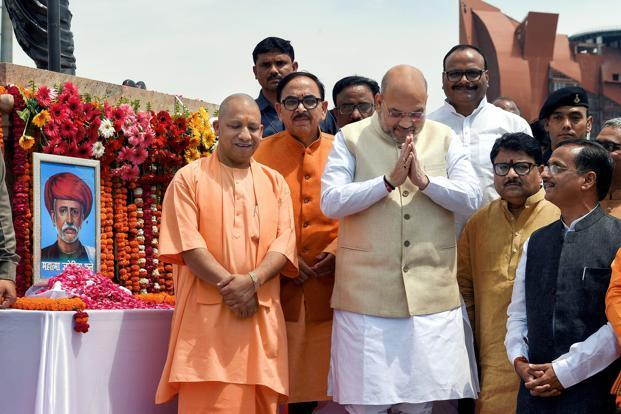 BJP national president Amit Shah and Uttar Pradesh chief minister Yogi Adityanath after paying tribute to social reformer Jyotiba Phule on his birth anniversary in Lucknow on Wednesday. Photo: PTI