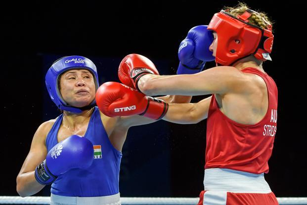India's Sarita Devi competes with Australia's Anja Stridsman in the women's 60kg quarterfinal boxing match on the seventh day of the Commonwealth Games 2018 at Oxenford Studios in Gold Coast, on Wednesday. Photo: PTI