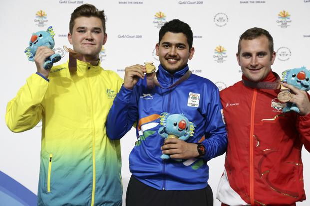 Anish Bhanwala, centre, on Friday created history by becoming India's youngest ever gold medal winner in the Commonwealth Games 2018 in Australia.  Photo: AP