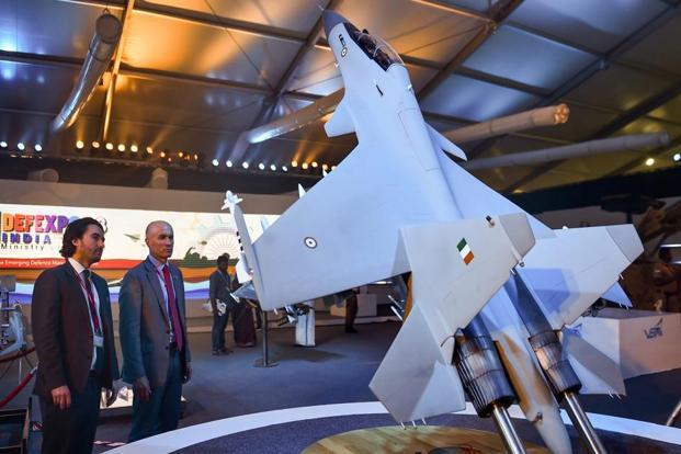 Foreign visitors look at a model of the Sukhoi Su-30 military jet on the third day of DefExpo 2018 at Tiruvidandhai, on the outskirts of Chennai on Friday. Photo: PTI