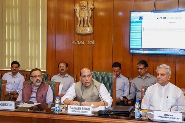 Home minister Rajnath Singh (centre) at the launch of e-FRRO application. Photo: PTI