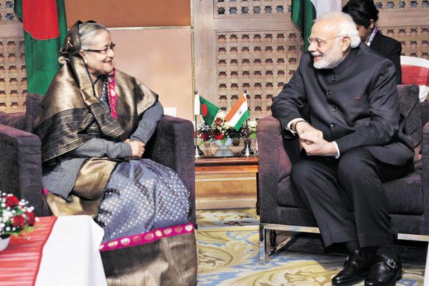 Narendra Modi and Sheikh Hasina. Bangladesh's interest in Indian solar power comes at a time Indian companies are eyeing long-term deals with Bangladesh companies for supplying domestic cooking gas and other petroleum products. Photo: Mint