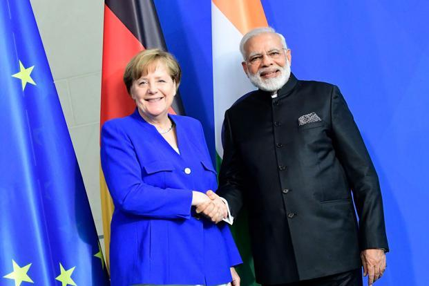 A file photo of Prime Minister Narendra Modi and German Chancellor Angela Merkel. Photo: AFP