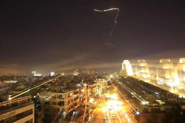 Syria's capital has been rocked by loud explosions that lit up the sky with heavy smoke as US President Donald Trump announced airstrikes in retaliation for the country's alleged use of chemical weapons. Photo: AP