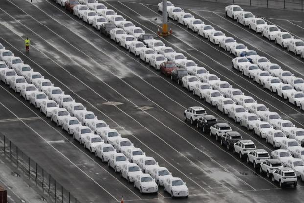 A worker walks between rows of Jaguar and Land Rover cars as they wait to be shipped from peel ports container terminal in liverpool, UK. File photo: Reuters