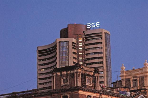 Sensex falls almost  300 points; Infosys tanks 4%