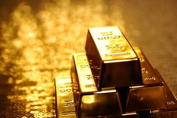 Gold inches up as dollar slides, but risk premium fades